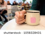 cup of tea. in the cafe place.... | Shutterstock . vector #1058328431