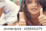 closeup image of smiling little ... | Shutterstock . vector #1058331275