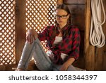 cowboy girl in west saloon with ... | Shutterstock . vector #1058344397