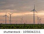 wind farm of wind turbines | Shutterstock . vector #1058362211