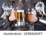 knight wearing armor and... | Shutterstock . vector #1058365697