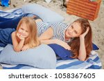 mom and daughter are lying on... | Shutterstock . vector #1058367605