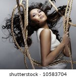 young woman hanging on the ropes - stock photo