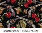 embroidery skull  crossed guns  ... | Shutterstock .eps vector #1058376329