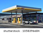 uno x sign and gas station  ... | Shutterstock . vector #1058396684