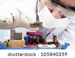 Young scientist installing a microchip computer on the motherboard - stock photo