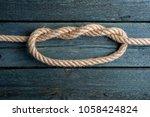 double overhand knot. rope node | Shutterstock . vector #1058424824