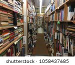 rows of vintage books in used... | Shutterstock . vector #1058437685