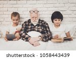 grandfather  grandson and...   Shutterstock . vector #1058443439