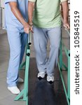 Senior man having ambulatory therapy with his therapist. - stock photo