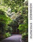path in meiji jingu shrine ... | Shutterstock . vector #1058480354