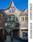 Small photo of Norwich, Norfolk, England - February 25 2018 : View of the exterior entrance of the art nouveau styled Royal Arcade, a covered shopping street in Norwich, designed by George Skipper in 1899