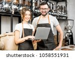 coffee store owners or managers ... | Shutterstock . vector #1058551931