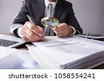 close up of a businessperson's... | Shutterstock . vector #1058554241