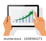 hand holding tablet with...   Shutterstock .eps vector #1058584271