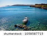 small fishing boat moored at... | Shutterstock . vector #1058587715