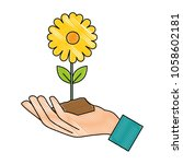 hand with beautiful sunflower... | Shutterstock .eps vector #1058602181