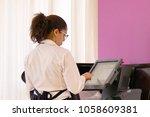 a waitress registrating new... | Shutterstock . vector #1058609381
