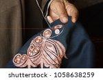 embroidering a spiral zari... | Shutterstock . vector #1058638259