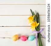 easter eggs in a row on bottom... | Shutterstock . vector #1058656124
