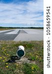 Small photo of Aviation / Laesoe / Denmark: Beacon at the end of the runway of the small airfield in Byrum