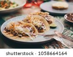 mexican spicy tacos served for... | Shutterstock . vector #1058664164