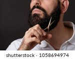 cropped image of bearded man... | Shutterstock . vector #1058694974