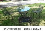 the cast iron table and chair... | Shutterstock . vector #1058716625