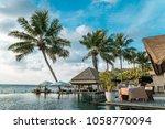 luxury swimming pool in... | Shutterstock . vector #1058770094
