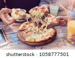 eating food. close up of people ... | Shutterstock . vector #1058777501