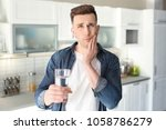 young man with sensitive teeth...   Shutterstock . vector #1058786279