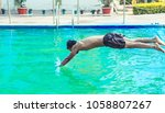 handsome male diving in a... | Shutterstock . vector #1058807267
