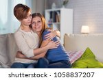 homosexual couple of lesbian... | Shutterstock . vector #1058837207