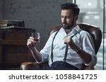handsome pensive man is holding ... | Shutterstock . vector #1058841725