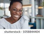 headshot of positive attractive ... | Shutterstock . vector #1058844404