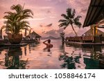 luxury swimming pool in... | Shutterstock . vector #1058846174