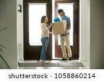 happy young woman receiving... | Shutterstock . vector #1058860214