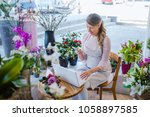 florist taking orders on the... | Shutterstock . vector #1058897585