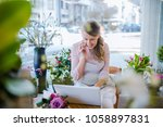 florist taking orders on the... | Shutterstock . vector #1058897831
