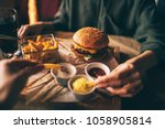 group of friends eating at fast ... | Shutterstock . vector #1058905814