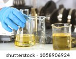 male hands in protective gloves ... | Shutterstock . vector #1058906924