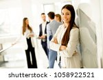young businesswoman standing in ... | Shutterstock . vector #1058922521