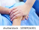 Small photo of Touching hands Asian senior or elderly old lady woman patient with love, care, encourage and empathy at nursing hospital : healthy strong medical concept