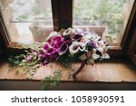 bouquet of red  white flowers... | Shutterstock . vector #1058930591
