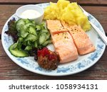 salmon with mashed potatoes and ... | Shutterstock . vector #1058934131