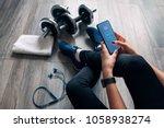 girl uses fitness app   Shutterstock . vector #1058938274