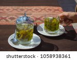 tea cups with coca leaves...   Shutterstock . vector #1058938361