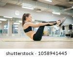 slim young woman in activewear... | Shutterstock . vector #1058941445