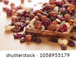 close up mix different of nuts... | Shutterstock . vector #1058955179
