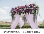 arch  decorated with fabric and ... | Shutterstock . vector #1058961869